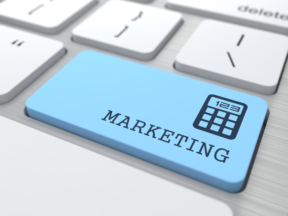 Marketing Concept. Marketing Word on Blue Computer Button.